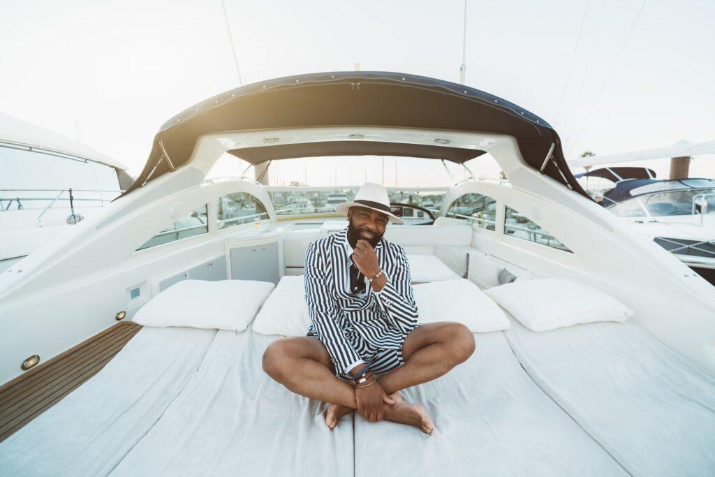 A black man on a luxury yacht