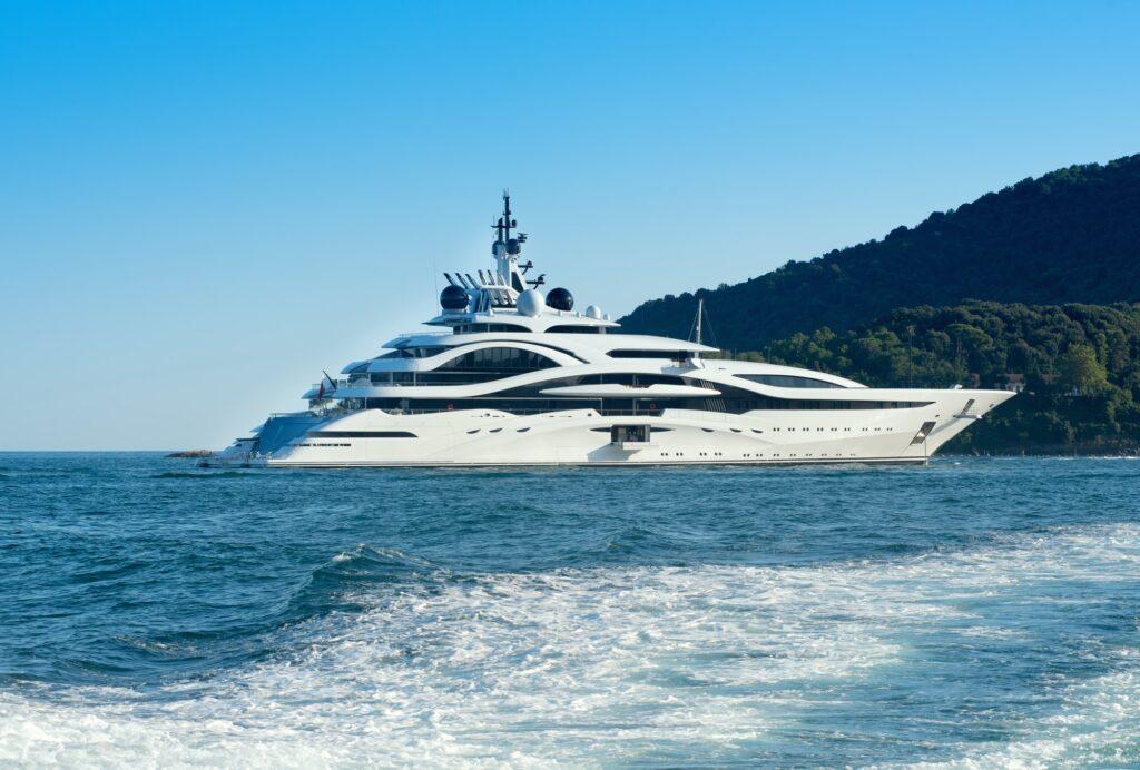 Huge luxury yacht cruising offshore